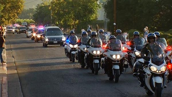 A procession of CHP cars and motorcycles left a funeral chapel in Saint Helena at 7:30 this morning.