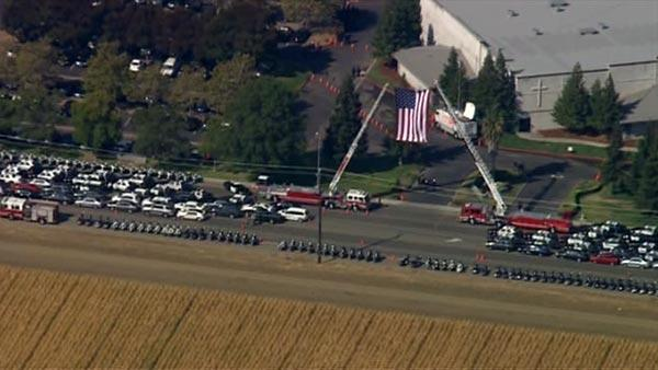 Flag flying over CHP Officer Kenyon Youngstrom's funeral