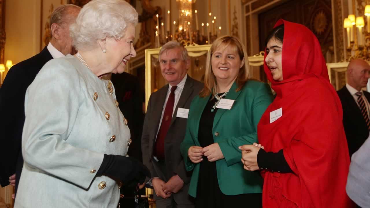Britains Queen Elizabeth II meets Malala Yousafzai.