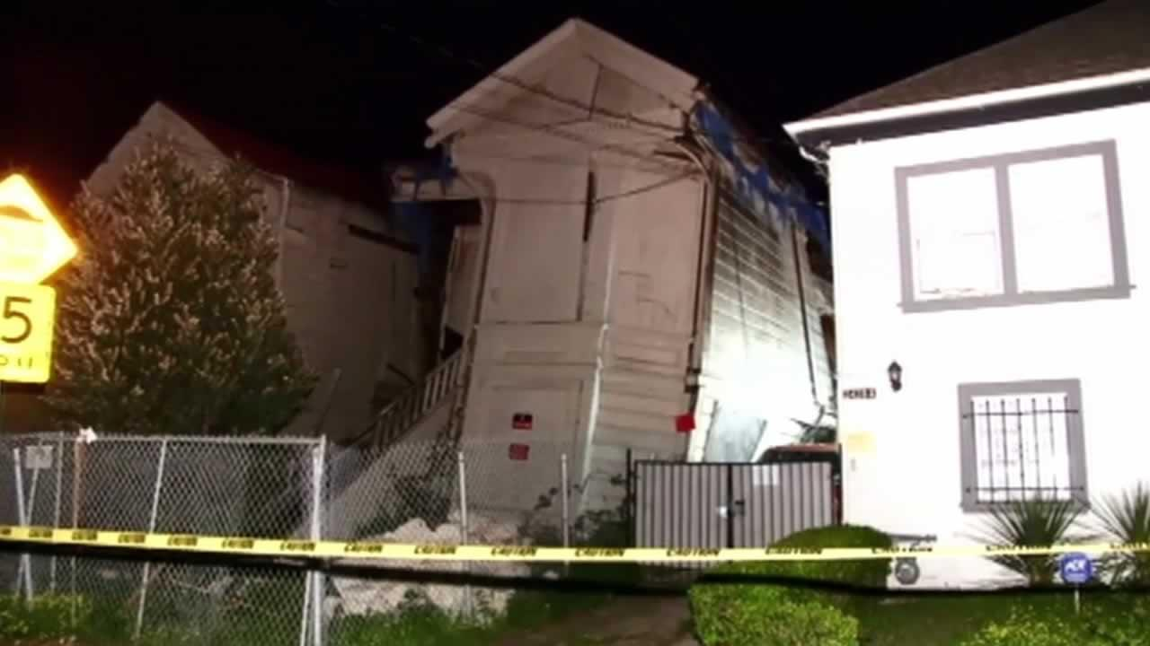 A wall of a two-story Victorian home in Oakland that was  undergoing renovation partially collapsed Thursday evening.