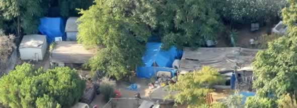 Makeshift tents and other structures fill a backyard where authorities say kidnap victim Jaycee Lee Dugard lived in Antioch, Calif., on Aug. 28, 2009. The world already was riveted by the case of Jaycee Dugard, abducted as an 11-year-old while walking to school and held as a sex slave for 18 years in the backyard of a paroled rapist. But the testimony she gave to a grand jury, released Thursday, June 2, 2011, after her captor and his wife were sentenced to prison, shows the horror she endured in painful detail and opens a window into the dark mind of a manipulative serial sex offender. (AP Photo/Noah Berger)