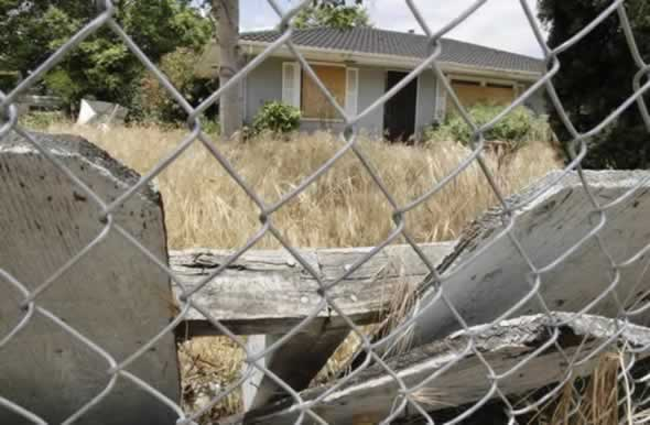 This is the fenced off house in Antioch, Calif., Thursday, June 2, 2011, where authorities say Phillip and Nancy Garrido abducted Jaycee Dugard, 11, and drove her to this home and held her prisoner there for 18 years. Phillip Garrido was ordered on Thursday to spend the rest of his life in prison. (AP Photo/Paul Sakuma)