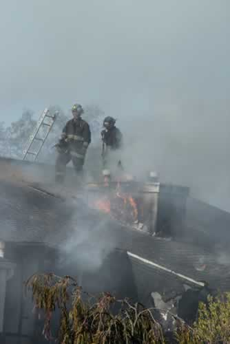Firefighters work to extinguish a two-alarm...