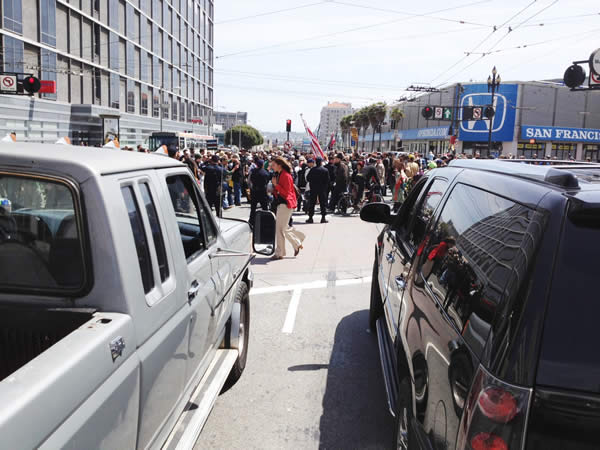 May Day protesters march on Vanness and Market streets in San Francisco (Cathy Cavey/KGO)