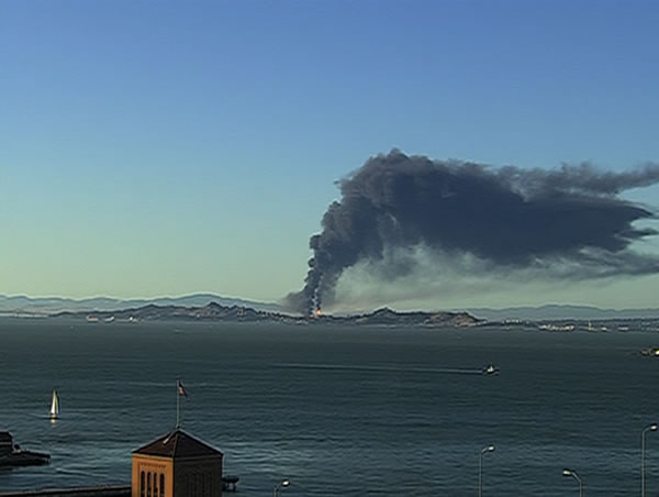 A large plume of black smoke from the Chevron Refinery in Richmond is visible across the Bay. (ABC7 News)