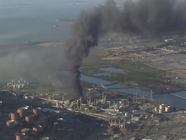 A large plume of black smoke from the Chevron Refinery in Richmond is visible from high in the sky. (ABC7 News)