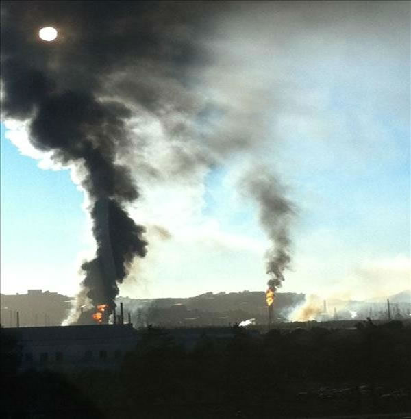 A visible fire could be seen burning at the Chevron Refinery in Richmond and a large black plume of smoke. This is another view from the fire.  (Photo sent in by Helen Patterson via uReport)