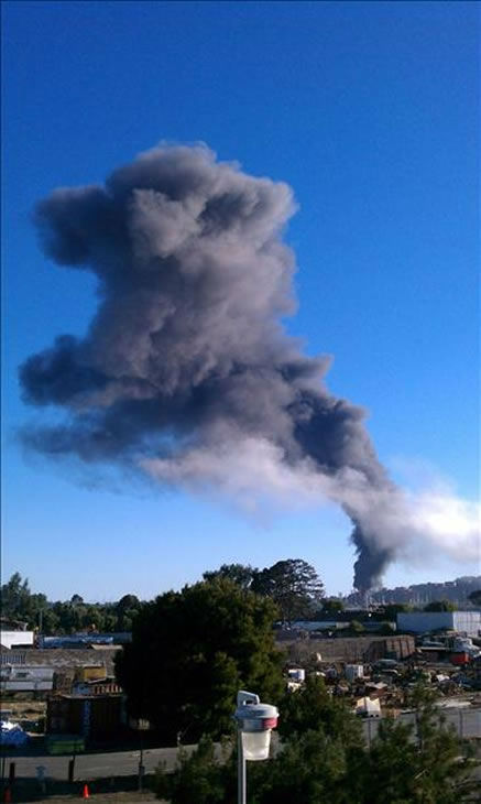 A visible fire could be seen burning at the Chevron Refinery in Richmond and a large black plume of smoke. This is a view from North Richmond. (Photo sent in by a viewer via uReport)