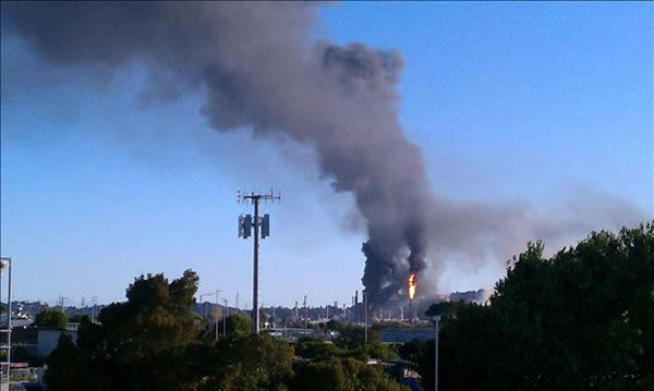 "<div class=""meta ""><span class=""caption-text "">A visible fire could be seen burning at the Chevron Refinery in Richmond and a large black plume of smoke. This is another view from the fire.  (Photo sent in by a viewer via uReport) </span></div>"