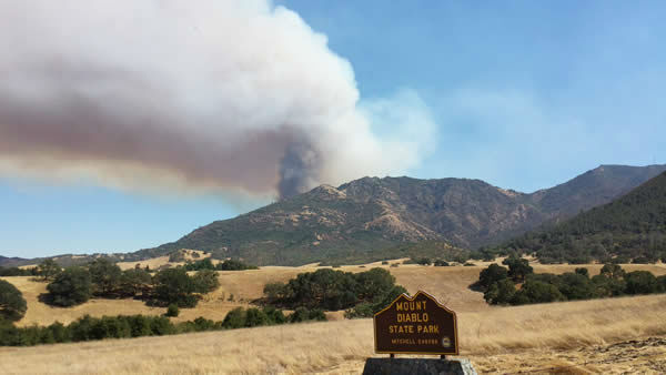 "<div class=""meta ""><span class=""caption-text "">Smoke from a wildfire that crews are battling on the slopes of Mount Diablo was visible from several miles away. (Photo submitted via uReport)</span></div>"