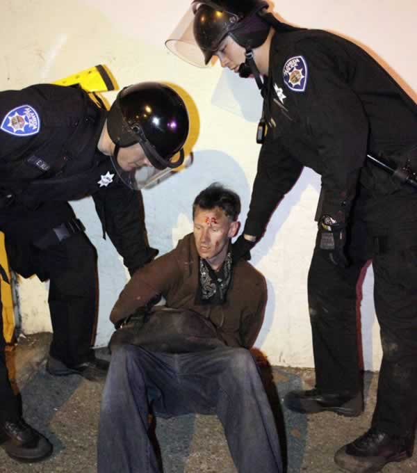 "<div class=""meta image-caption""><div class=""origin-logo origin-image ""><span></span></div><span class=""caption-text"">Police hold a demonstrator after the sentencing in Oakland, Calif., Friday, Nov. 5, 2010 of former Bay Area Rapid Transit police officer Johannes Mehserle. Mehserle was convicted of involuntary manslaughter for the fatal shooting of Oscar Grant at a BART station on Jan. 1, 2009. Los Angeles Superior Court Judge Robert Perry sentenced Mehserle  to two years in prison. (AP Photo/Paul Sakuma)  </span></div>"