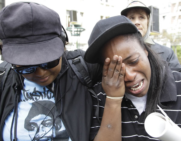 "<div class=""meta ""><span class=""caption-text "">Kim Webber, right, looks emotional after hearing the sentencing of former Bay Area Rapid Transit police officer Johannes Mehserle in Oakland, Calif., Friday, Nov. 5, 2010. Mehserle was convicted of involuntary manslaughter for the fatal shooting of Oscar Grant at a BART station on Jan. 1, 2009. Los Angeles Superior Court Judge Robert Perry sentenced Mehserle to two years in prison. (AP Photo/Paul Sakuma)  </span></div>"