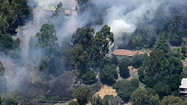 "<div class=""meta ""><span class=""caption-text "">Firefighters battled a 2-alarm brush fire in the Oakland Hills on Friday afternoon, June 8, 2012. (KGO)</span></div>"