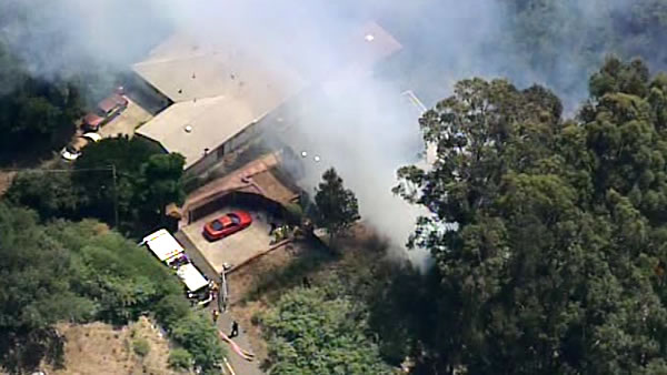 Firefighters battled a 2-alarm brush fire in the Oakland Hills on Friday afternoon, June 8, 2012. <span class=meta>(KGO)</span>