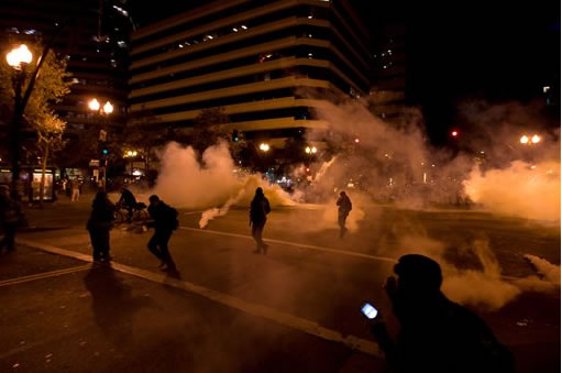 "<div class=""meta ""><span class=""caption-text "">Occupy Wall Street protesters run from tear gas deployed by police at 14th Street and Broadway in Oakland, Calif., Tuesday, Oct. 25, 2011. (AP Photo/Darryl Bush)</span></div>"