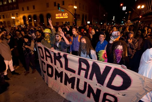 Occupy Wall Street protesters yell towards police stopping their path at 14th and Broadway Streets in Oakland, Calif., Tuesday, Oct. 25, 2011. (AP Photo/Darryl Bush)
