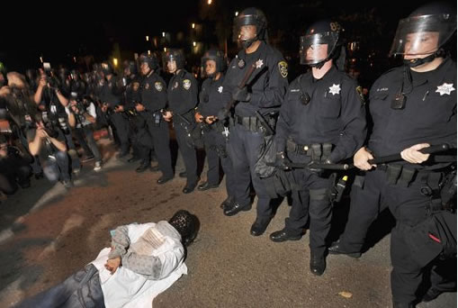 "<div class=""meta image-caption""><div class=""origin-logo origin-image ""><span></span></div><span class=""caption-text"">A demonstrator lies on ground in protest after the sentencing in Oakland, Calif., Friday, Nov. 5, 2010 of former Bay Area Rapid Transit police officer Johannes Mehserle. Mehserle was convicted of involuntary manslaughter for the fatal shooting of Oscar Grant at a BART station on Jan. 1, 2009. Los Angeles Superior Court Judge Robert Perry sentenced Mehserle  to two years in prison. (AP Photo/Noah Berger)</span></div>"