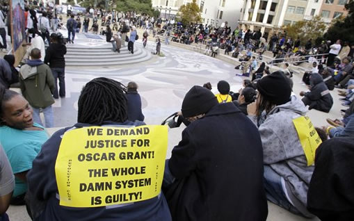 Hundreds of demonstrators attend a rally after the sentencing of former Bay Area Rapid Transit police officer Johannes Mehserle in Oakland, Calif., Friday, Nov. 5, 2010. Mehserle was convicted of involuntary manslaughter for the fatal shooting of Oscar Grant at a BART station on Jan. 1, 2009. Los Angeles Superior Court Judge Robert Perry sentenced Mehserle  to two years in prison. (AP Photo/Paul Sakuma)