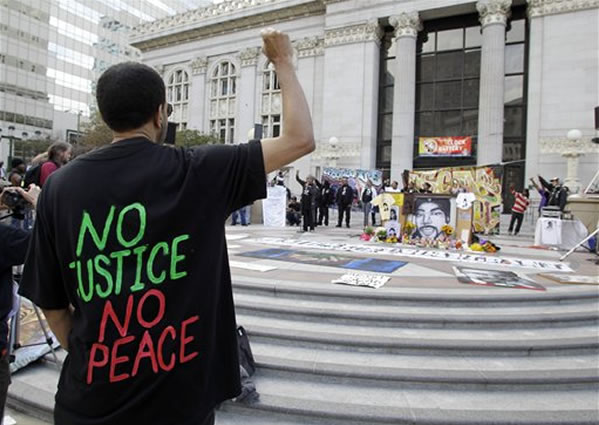 "<div class=""meta ""><span class=""caption-text "">Demonstrators raise their arms in protest after the sentencing of former Bay Area Rapid Transit police officer Johannes Mehserle in Oakland, Calif., Friday, Nov. 5, 2010. Mehserle was convicted of involuntary manslaughter for the fatal shooting of Oscar Grant at a BART station on Jan. 1, 2009. Los Angeles Superior Court Judge Robert Perry sentenced Mehserle  to two years in prison. (AP Photo/Paul Sakuma)</span></div>"
