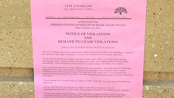 "This is one of the pink notices that the ""Occupy Oakland"" group received."