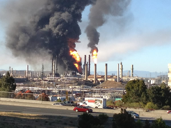 A visible fire and large plumes of smoke could be seen burning at the Chevron refinery in Richmond. (submitted by Marin TV via uReport)