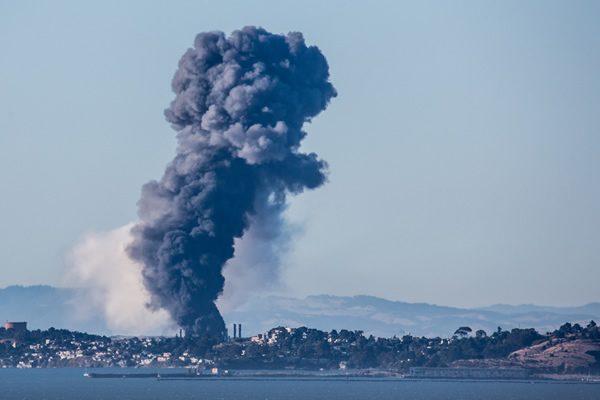 A visible fire and large plumes of smoke could be seen burning at the Chevron refinery in Richmond. (submitted by Phil McGrew via uReport)