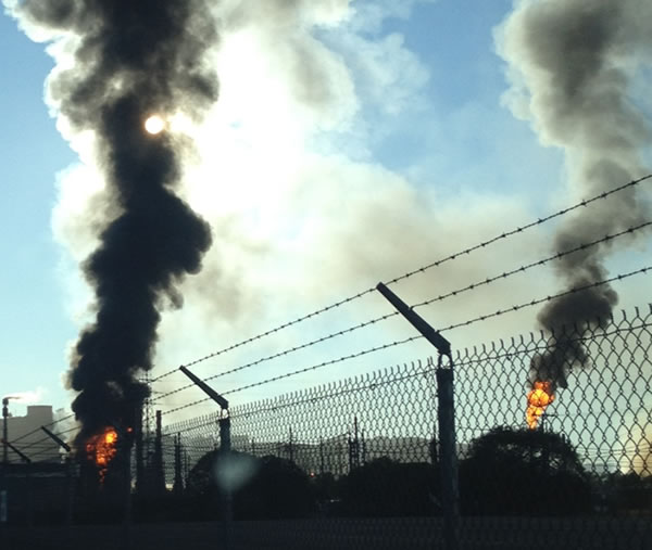 "<div class=""meta image-caption""><div class=""origin-logo origin-image ""><span></span></div><span class=""caption-text"">A visible fire and large plumes of smoke could be seen burning at the Chevron refinery in Richmond. (submitted via uReport)</span></div>"
