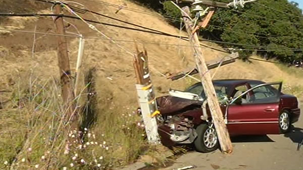 These are photos from a car accident in Oakland which sparked a hillside fire Friday afternoon. The car smashed into a pole, which broke in three places, and part of the light pole almost hit the driver. She was able to exit the vehicle, was taken to the hospital, and is in stable condition.
