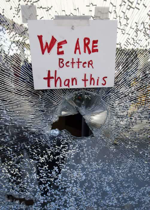 A broken window is seen at a Chase bank in Oakland, Calif., Weds., Nov. 2, 2011. Protesters are carrying out a series of marches across Oakland on Wednesday to make a statement about the power and unity of the anti-Wall Street movement as they team up with labor unions to picket banks, take over foreclosed homes and vacant buildings and disrupt operations at the nation's fifth-busiest port. (AP Photo/Paul Sakuma)