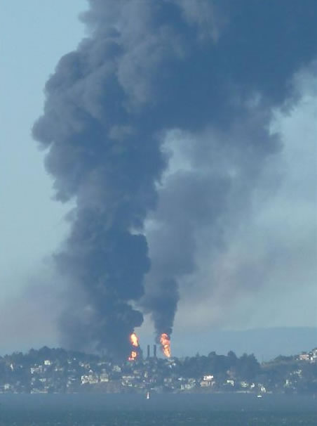 A visible fire could be seen burning at the Chevron Refinery in Richmond and a large black plume of smoke. This is the view from Telegraph Hill in San Francisco. (Photo sent in by fotonut via uReport)