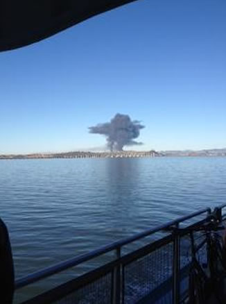 "<div class=""meta ""><span class=""caption-text "">A visible fire could be seen burning at the Chevron Refinery in Richmond and a large black plume of smoke. (Photo sent in by a viewer via uReport)</span></div>"