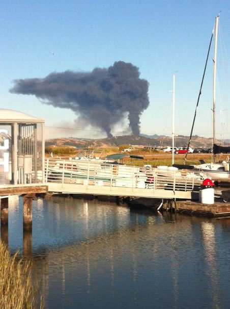 A visible fire could be seen burning at the Chevron Refinery in Richmond and a large black plume of smoke. This is a photo that was taken during a viewer's bike ride in San Rafael. (Photo sent in by a viewer via uReport)