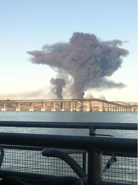A visible fire could be seen burning at the Chevron Refinery in Richmond and a large black plume of smoke. This is a photo that was taken from a ferry crossing the bay. (Photo sent in by Ellen C. via uReport)