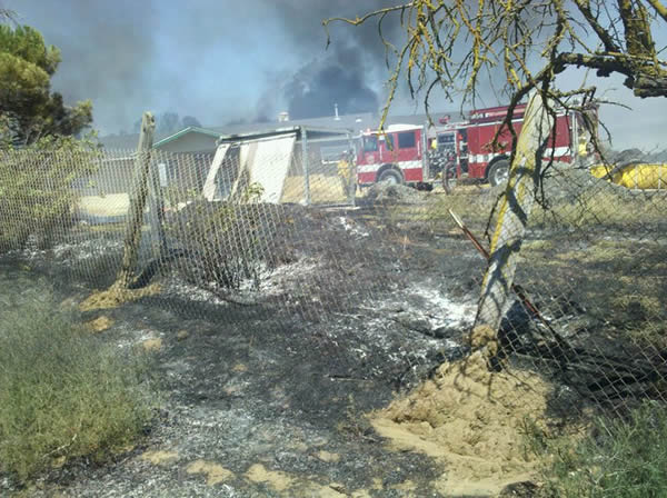 Series of small fires along railroad tracks near Oakley.  The fire hit the back portion of a resident&#39;s property.  Thursday 8&#47;4&#47;2011. <span class=meta>(Photo submitted by Ryan Murray via uReport)</span>