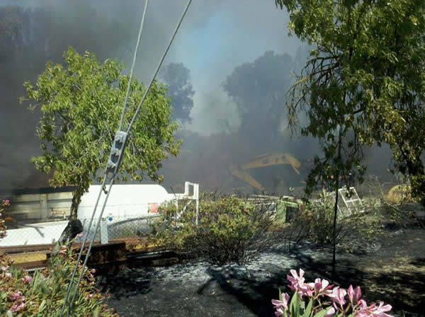 "<div class=""meta ""><span class=""caption-text "">Series of small fires along railroad tracks near Oakley.  The fire hit the back portion of a resident's property.  Thursday 8/4/2011. (Photo submitted by Ryan Murray via uReport)</span></div>"