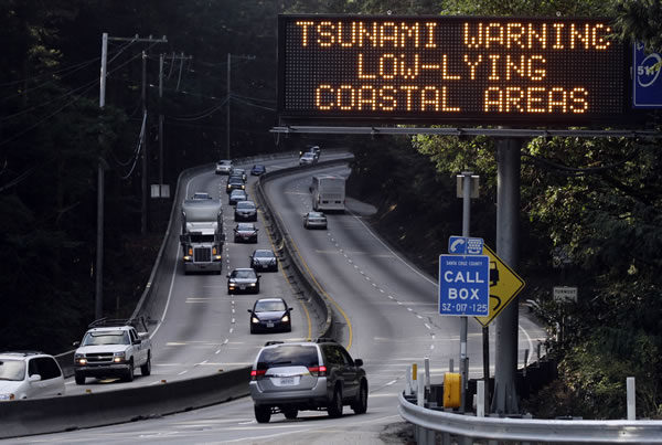 A tsunami warning is flashed along Highway 17 in the mountains leading to the coastal town of Santa Cruz, Calif., Friday, March 11, 2011. An 8.9-magnitude earthquake in Japan sparked a tsunami that moved across the Pacific triggering warnings as far away as the U.S. west coast. (AP Photo/Marcio Jose Sanchez)