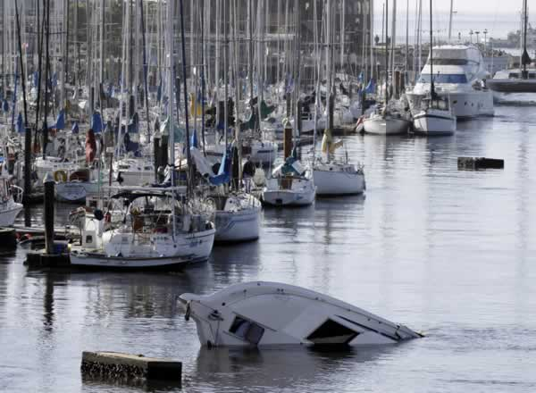 "<div class=""meta ""><span class=""caption-text "">A boat sinks into the ocean in the aftermath of the surge caused by a tsunami on the harbor in Santa Cruz, Calif., Friday, March 11, 2011. A ferocious tsunami unleashed by Japan's biggest recorded earthquake slammed into its eastern coast Friday, killing hundreds of people as it carried away ships, cars and homes, and triggered widespread fires that burned out of control. Hours later, the waves washed ashore on Hawaii and the U.S. West coast, where evacuations were ordered from California to Washington but little damage was reported. The entire Pacific had been put on alert _ including coastal areas of South America, Canada and Alaska _ but waves were not as bad as expected. (AP Photo/Marcio Jose Sanchez)  </span></div>"