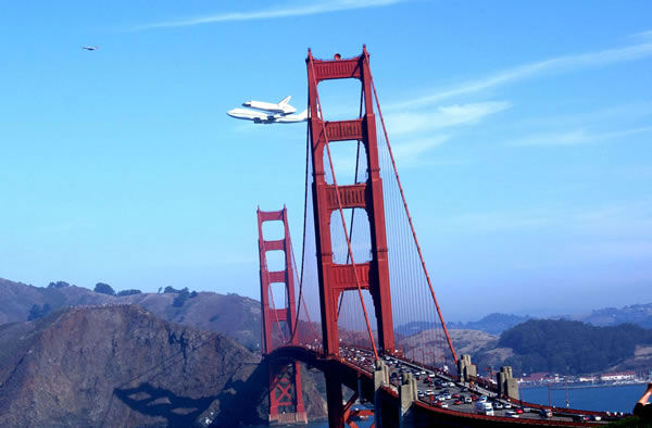 "<div class=""meta ""><span class=""caption-text "">Endeavour over the Golden Gate Bridge. (Photo submitted by gio-sunset via uReport) </span></div>"