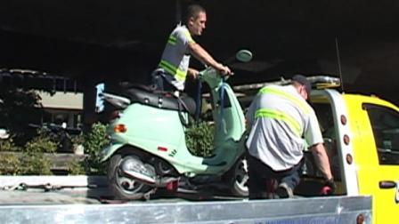 A person riding a scooter plummeted  off an elevated portion of Highway 101 in San Rafael onto a surface street below.