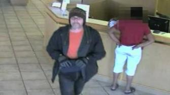 Surveillance video image showing the Cotton Ball Bandit on Sept. 4, 2013.