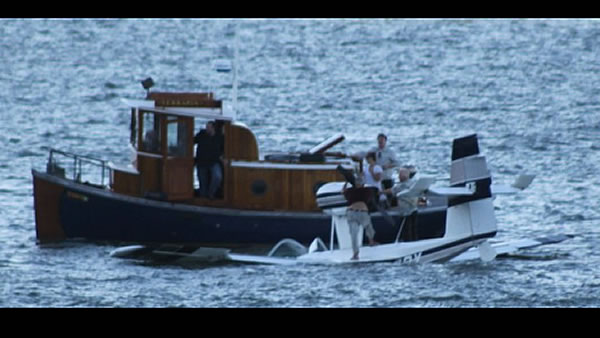 "<div class=""meta image-caption""><div class=""origin-logo origin-image ""><span></span></div><span class=""caption-text"">These are photos of Friday night's plane crash in Richardson Bay near Sausalito. The men were rescued by a boat passing by. (Photo submitted by Jennifer Franake and Mark Kahn)</span></div>"