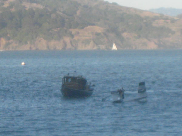 These are photos of Friday night's plane crash in Richardson Bay near Sausalito. The men were rescued by a boat passing by. (Photo submitted by John and Lily Mark)