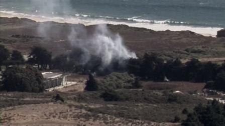 Firefighters have contained a vegetation fire that shut down state  Highway 1 along the San Mateo County coast.