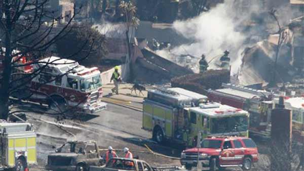Firefighters work in a neighborhood following a massive gas line explosion in San Bruno, Calif., Friday, Sept. 10, 2010.