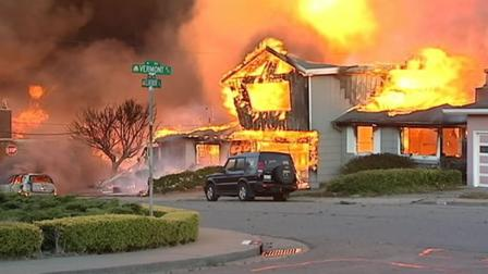 A home on fire after a PG&E gas pipeline exploded in a San Bruno neighborhood in September 2009.