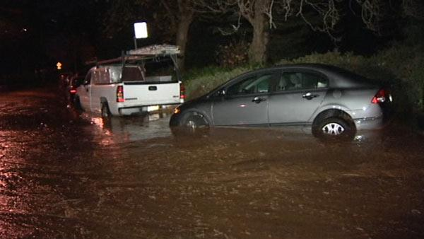 Flooded cars in Daly City