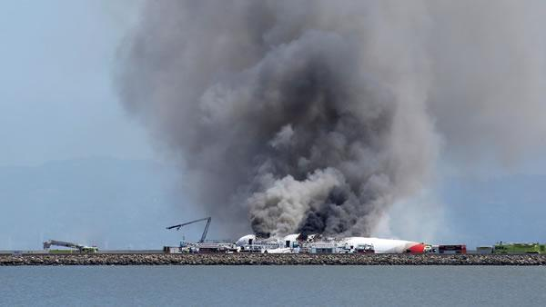 Fire crews put out fire of Asiana Airlines Boeing 777.