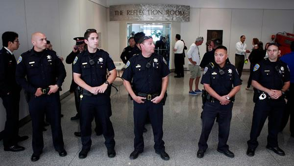 San Francisco Police stand guard at the Reflection Room at San Francisco International Airport.
