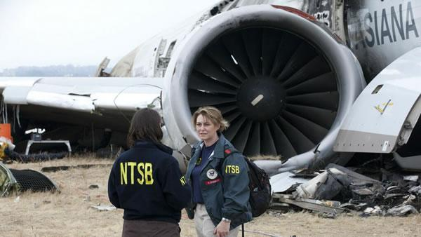 NTSB Chairman Hersman receives overview of accident site by NTSB engineer Erin Gormley.