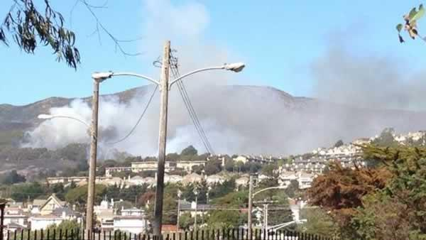 A four-alarm fire burning on San Bruno Mountain in South San Francisco sent a large plume of smoke in the air that was visible from several miles away. (Photo submitted via uReport by retired South San Francisco Fire Department Chief Russ Lee)